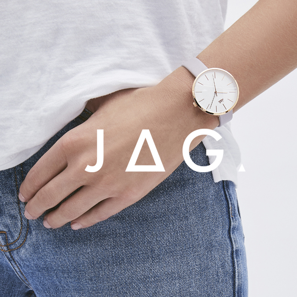 Midriff of a man wearing denim and a JAG watch