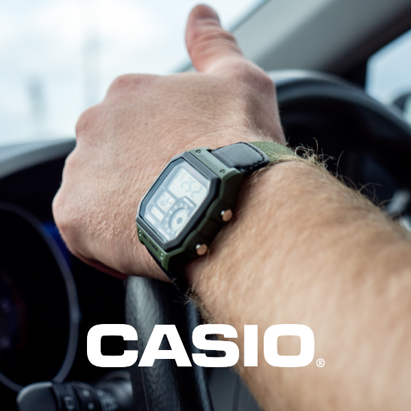 Casio watch on wrist while driving